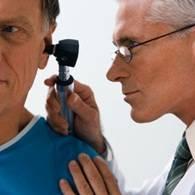 Doctor Looking Into Patient's Ear --- Image by © JLP/Jose Luis Pelaez/zefa/Corbis